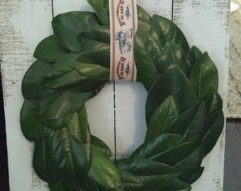 Magnolia wreath on pallet board with vintage ribbon{shabby chic style}