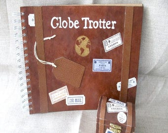 """Set """"travel"""" guestbook and wedding ring."""