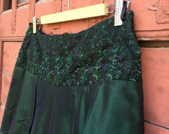 Silk taffeta wheeled skirt with emerald green bead Embroidery