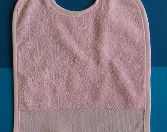 Pink bib to be personalized with cross stitch