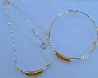 Silver and gold plated necklace and bangle set