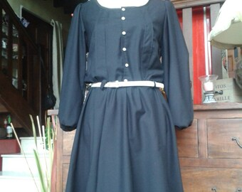 Black dress with thin stripes and white Pearly buttons