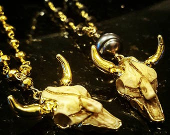 Gold 1 inche cow skull necklace.
