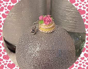 With icing on top clay miniature birthday cake charm. Miniature food charms