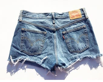 Levi Vintage Distressed Jean Shorts (size 2/3) distressed, high waised