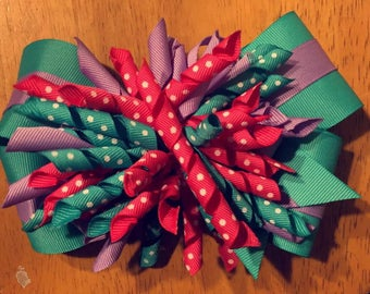 purple, teal and pink bow