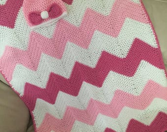 Baby blanket with baby hat.