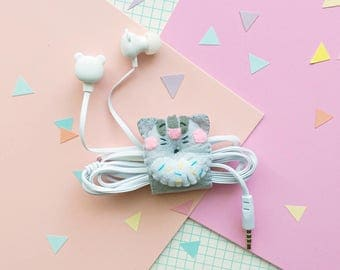 Cat donut earphone organizer with headphones, iphone earbuds, samsung earpods, phone accessories