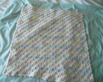 "Crochet dolls blanket in variegated pastel colors.  Could also be a rug for a play house.  25"" by 25"""