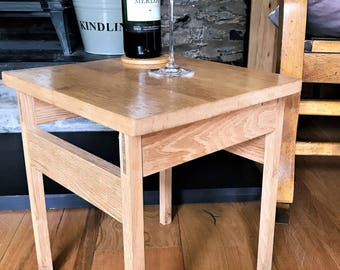 table, side, solid oak. Can also be used as a stool