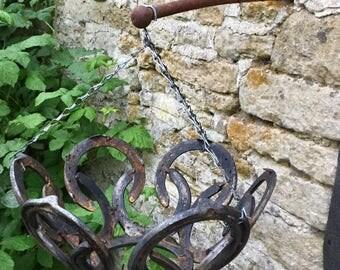 Horseshoe hanging basket