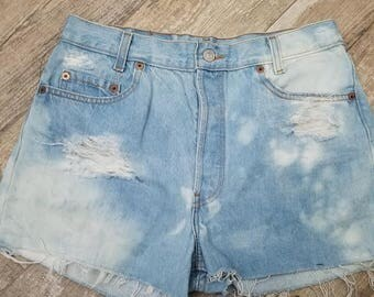 High waisted Bleached distressed Levi shorts.