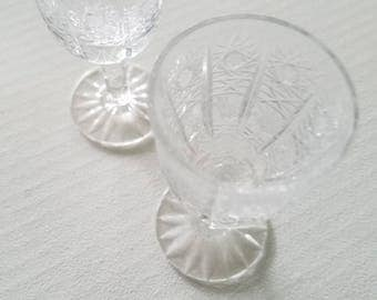 Two small crystal cordial glasses