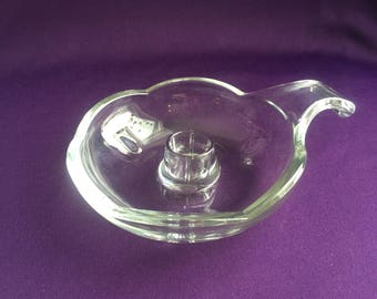 Glass candlestick holder with handle