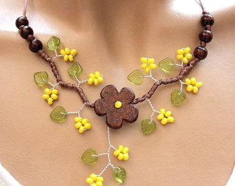 Brown/yellow/green floral ornament