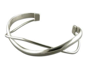 Wide And Narrow Crossover Waves Torc Sterling Silver Bangle
