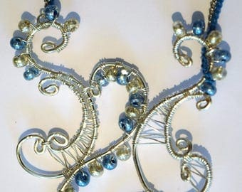 Blue and silver wire-wrapped curve pendant