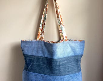 Blue jean tote bag with floral lining and straps