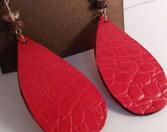 Earrings handcrafted from 100% genuine leather.
