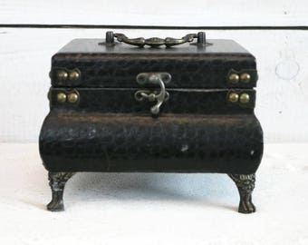 Beautiful Vintage Brass footed jewelry box with ornate carrying handle. Faux Snakeskin leather,  Black ornate trinket box