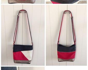 Bag has pink and blue shoulder bag