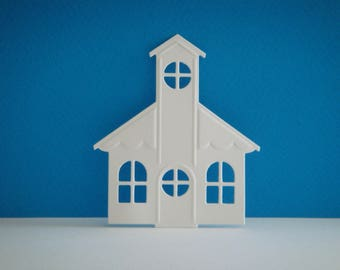 Cutting white Church in paper for scrapbooking and card