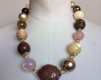 Stone necklace, wood ebony, rose quartz, yellow, straw, lucite.