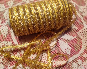 Small shiny textile golden lace