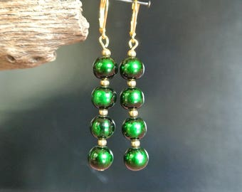Beautiful iridescent Green-Black for these earrings overlay 4 beads 8 mm round green-black 3 mm beads interspersed with gold