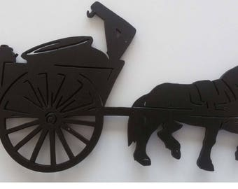 Tank and cut and painted, wooden silhouette style poya, mounted to the mountain horse