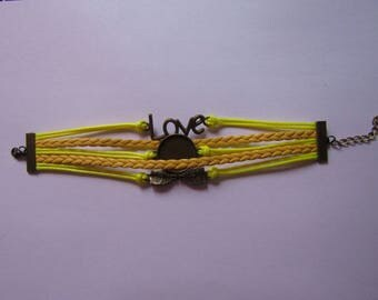 bronze and yellow color bracelet