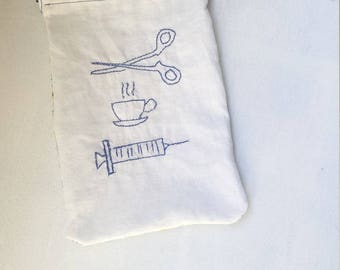 SuperNurse clutch/pouch to slip into a pocket or bag
