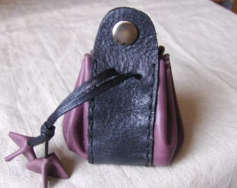 Coin purse is purple leather - hand sewn black