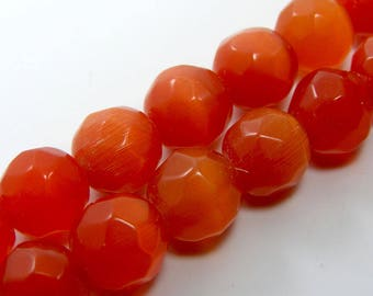 Set of 4 10 mm faceted cat's eye glass beads orange