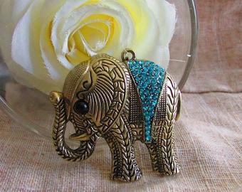 All bronze elephant pendant and rhinestones approx: 52 X 55 MM