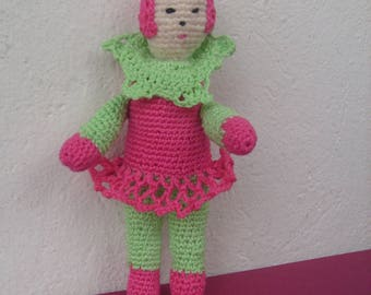 crocheted pink and green wool doll