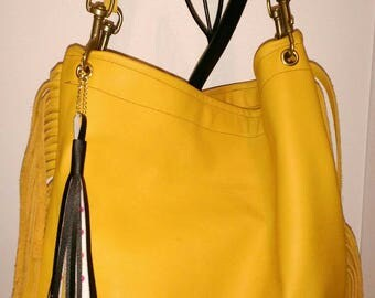 tote bag has yellow leather fringe