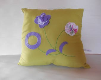 applied felt flowers and embroidered lime green pillow