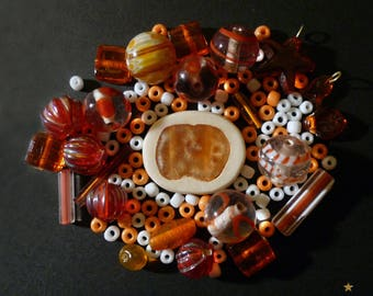 114 Indian orange, white with various shapes glass beads