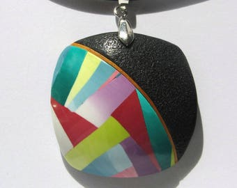 Rounded square polymer clay pendant.