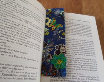bookmarks made of cardboard with a blue fabric with flowers and butterflies