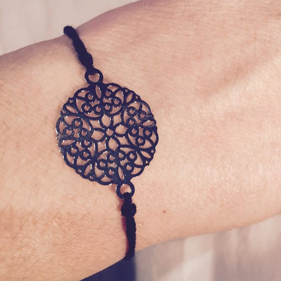 Black cord and silver rose bracelet