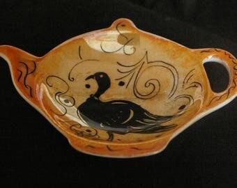 Bag Dimensions porcelain Teacup rests: 10 * 8 cm