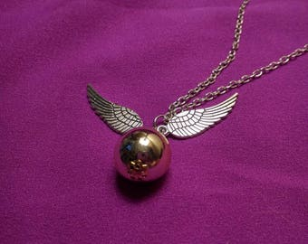 Harry Potter inspired Golden Snitch Necklace.