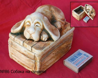 "Sculpture ""The dog on the box"""