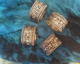 Vintage 70's four detailed napkin rings timeless