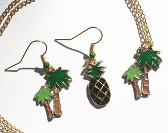 "Necklace and earrings mismatched Palm trees and pineapple black and green enamel on gold tone ""Tropical"" set."