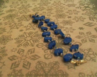 pretty bracelet made of beads and polymer clay blue and white