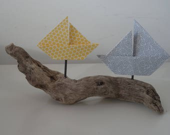 Decorative boat origami on Driftwood in mustard yellow-gray