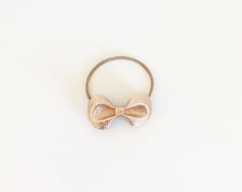 Rose gold pinch bow